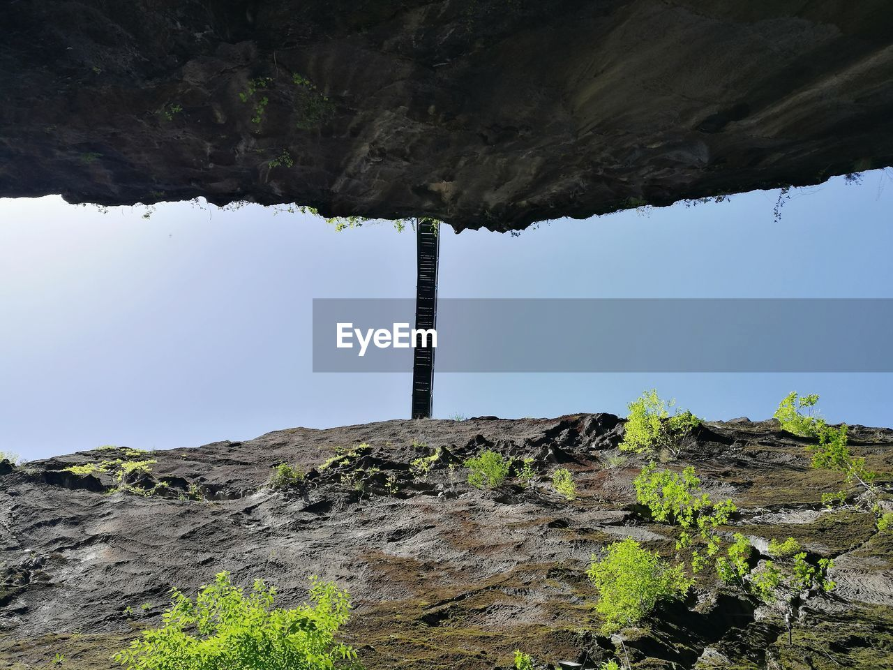 sky, nature, low angle view, rock, day, architecture, rock - object, no people, built structure, solid, mountain, outdoors, tranquility, beauty in nature, rock formation, scenics - nature, plant, tranquil scene, clear sky, environment