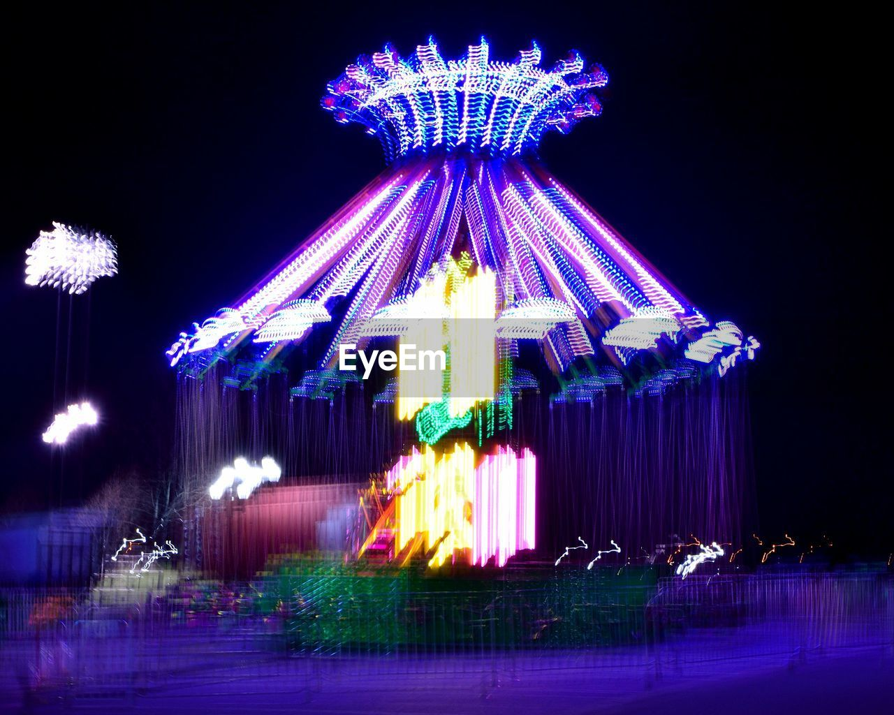night, illuminated, amusement park, arts culture and entertainment, amusement park ride, outdoors, motion, no people, carousel, clear sky, sky