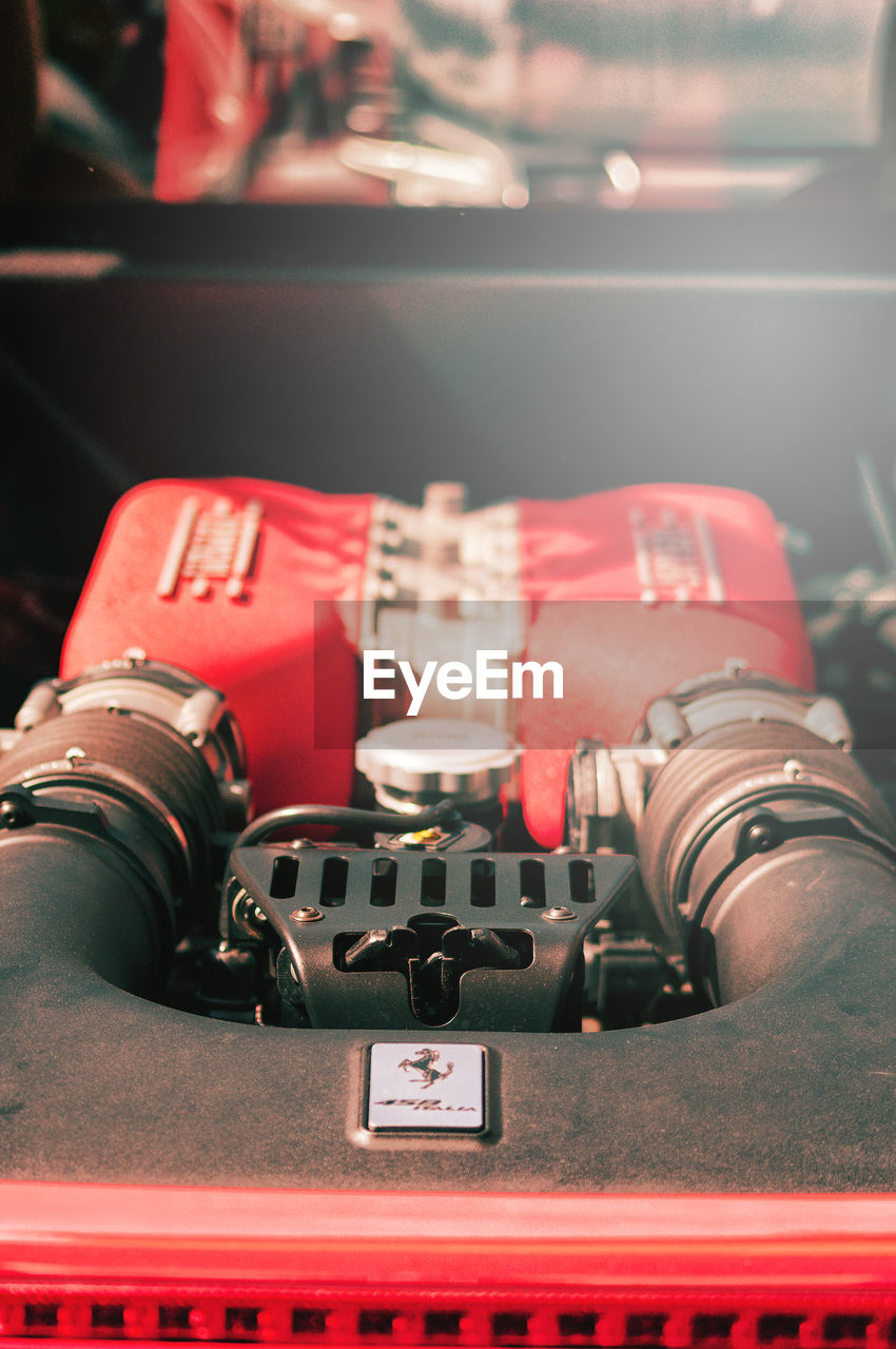 close-up, technology, indoors, no people, retro styled, red, control, transportation, land vehicle, selective focus, metal, still life, car, motor vehicle, mode of transportation, photography themes, security, high angle view, nostalgia