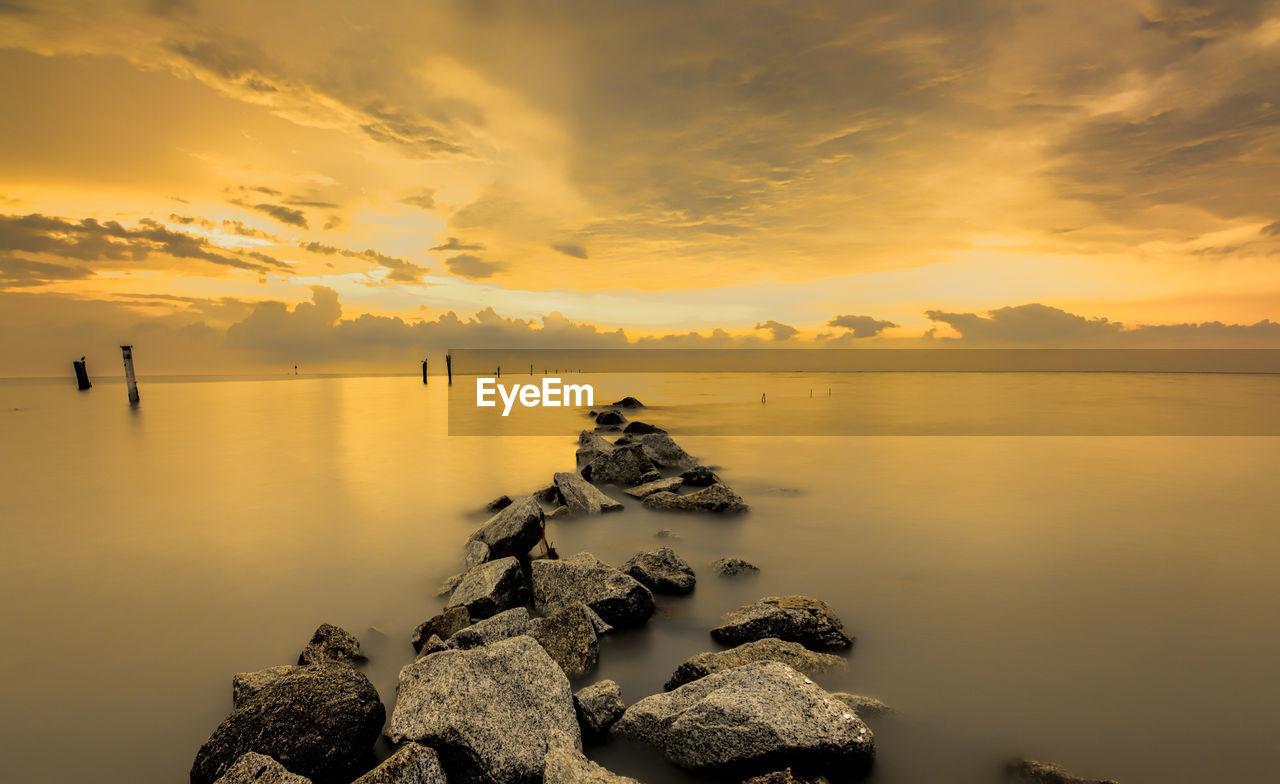 Calm Sea Against Scenic Sky