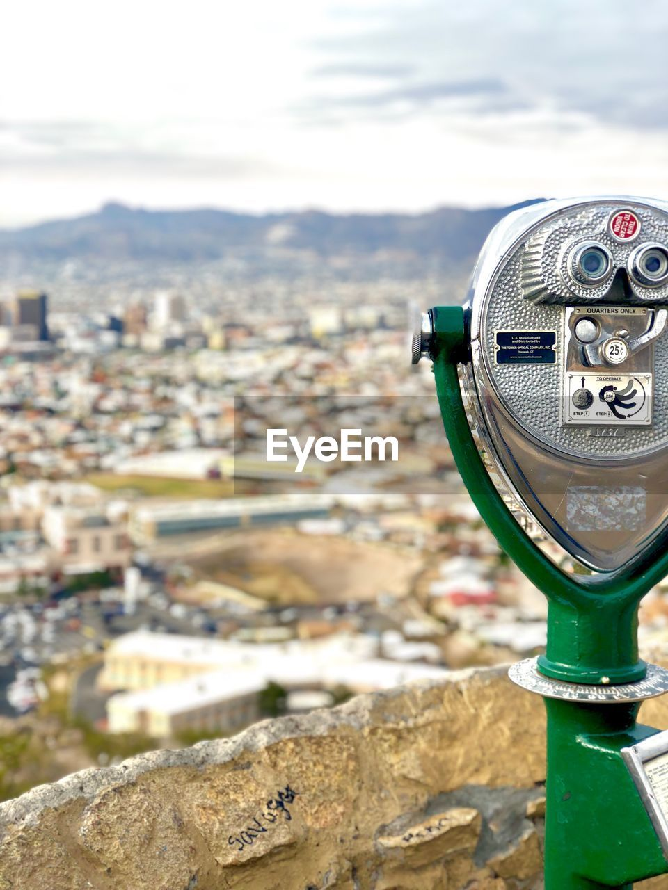 coin operated, binoculars, building exterior, city, architecture, focus on foreground, coin-operated binoculars, cityscape, built structure, day, sky, nature, close-up, no people, outdoors, building, metal, residential district, surveillance, hand-held telescope