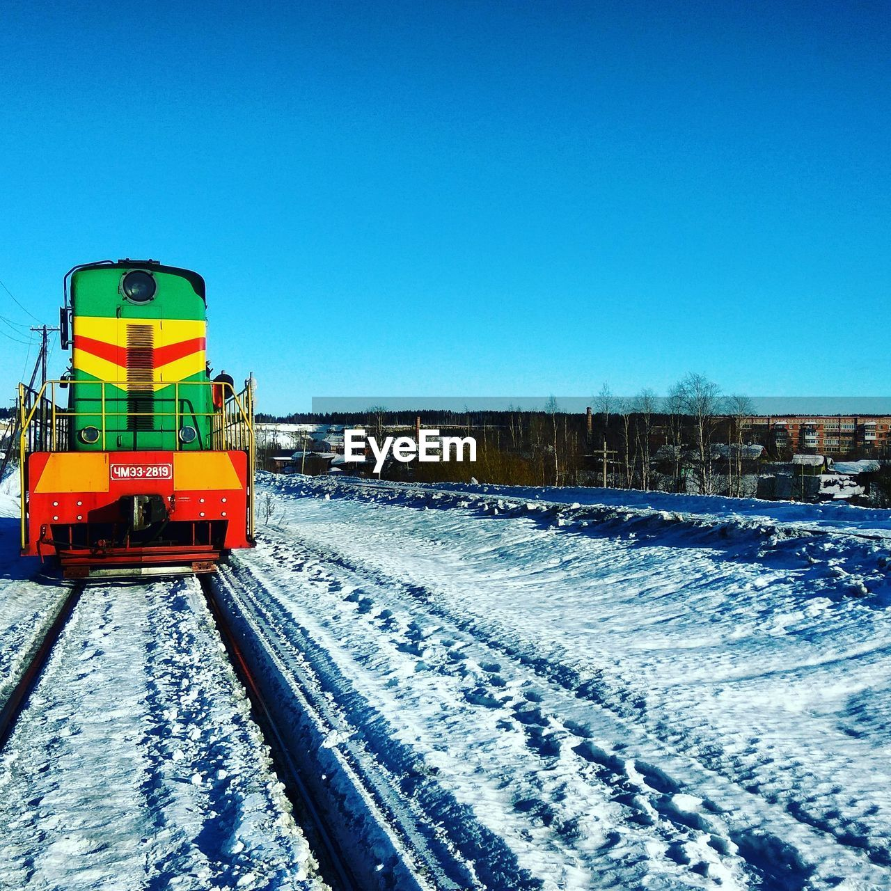 snow, winter, cold temperature, weather, clear sky, transportation, frozen, copy space, day, mode of transport, nature, outdoors, blue, railroad track, land vehicle, rail transportation, snowing, no people, landscape, beauty in nature, snowdrift, sky