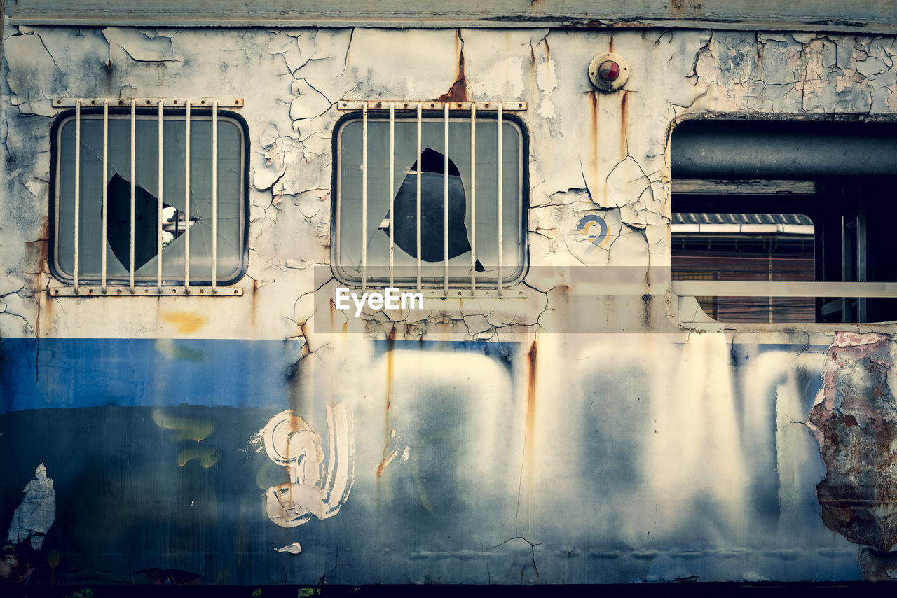 window, architecture, built structure, no people, day, building exterior, outdoors, smoke - physical structure, abandoned, old, building, communication, damaged, industry, nature, sunlight, sign, factory, glass - material, heat - temperature