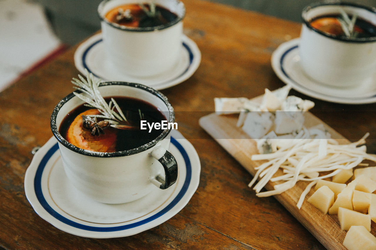 food and drink, table, food, freshness, drink, indoors, no people, cup, refreshment, still life, saucer, crockery, mug, high angle view, kitchen utensil, wood - material, focus on foreground, coffee, close-up, tea, hot drink, tea cup, tray