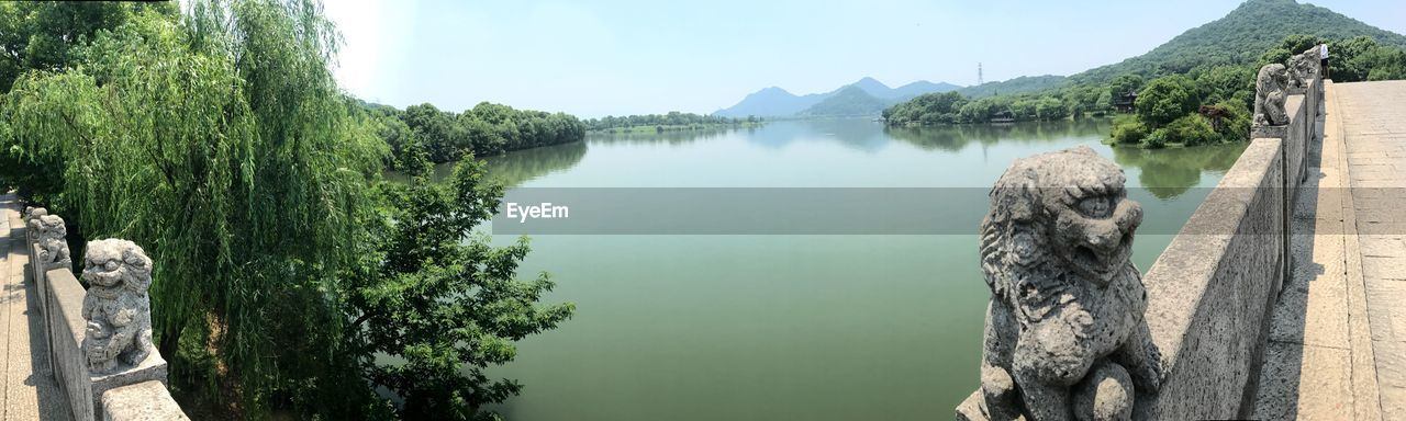 water, tree, plant, tranquility, scenics - nature, beauty in nature, tranquil scene, lake, nature, mountain, sky, day, no people, reflection, non-urban scene, green color, idyllic, outdoors, wooden post
