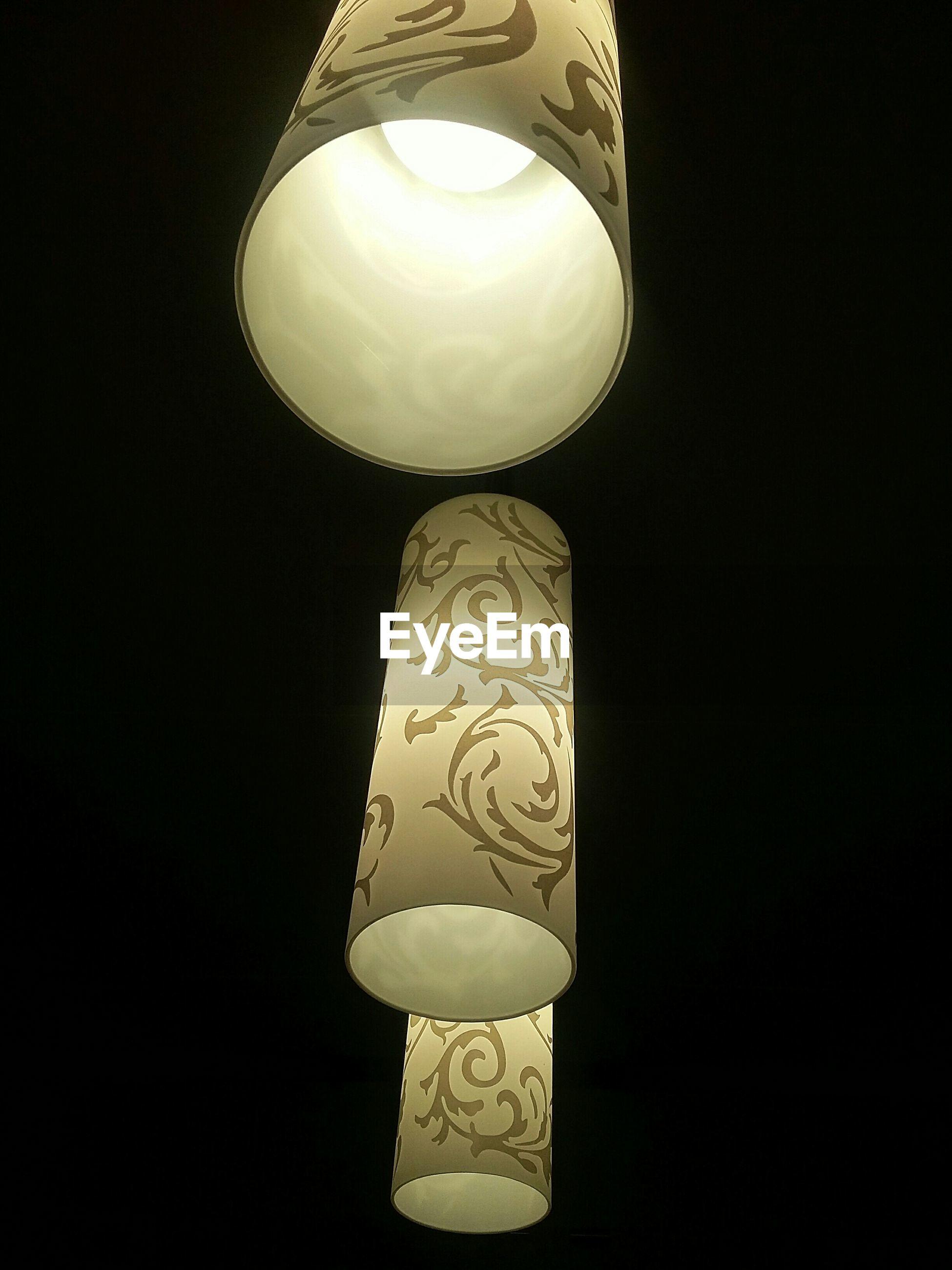 Illuminated lamps on black background