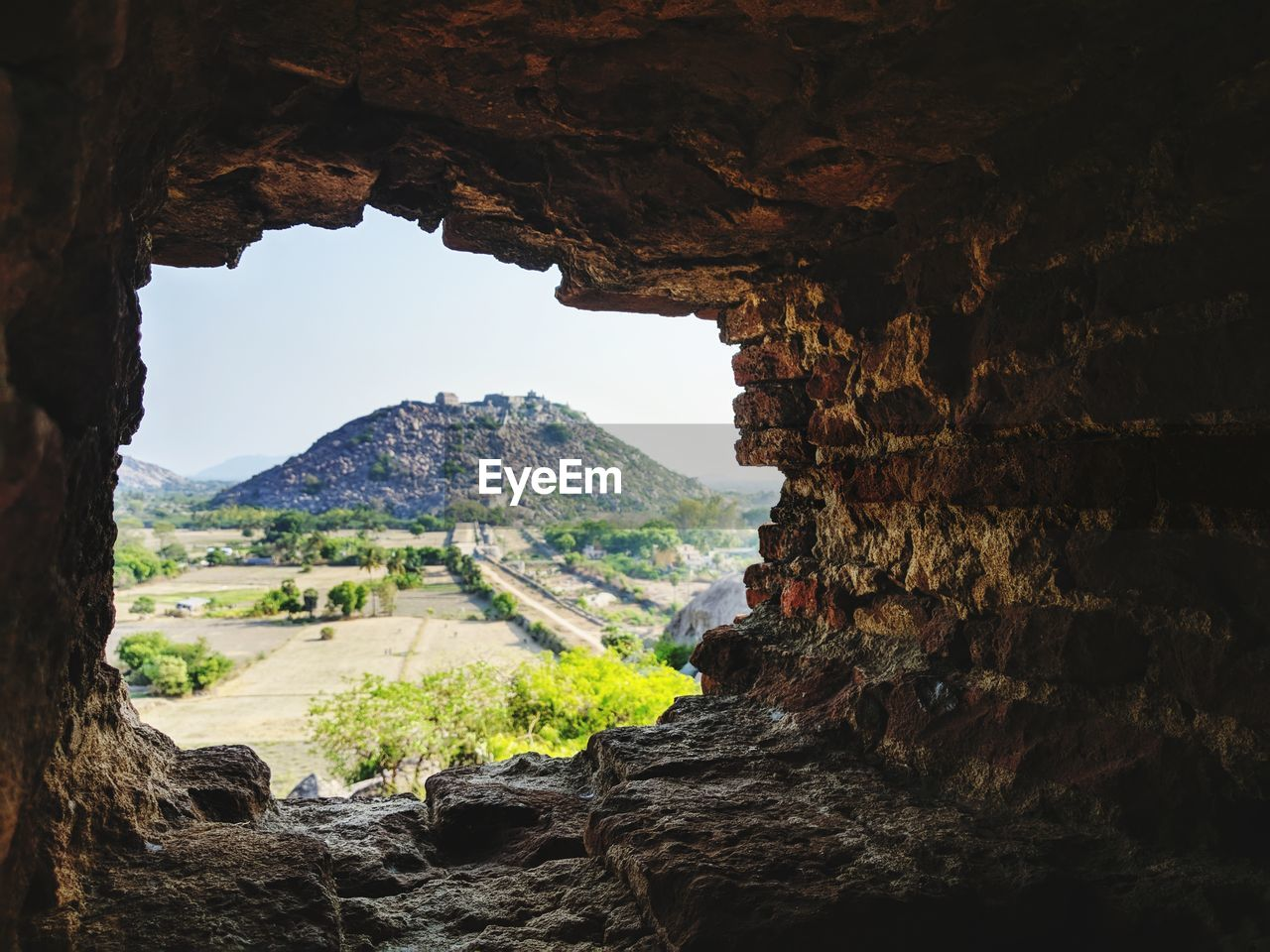 Scenic view of cave and rock formation against sky