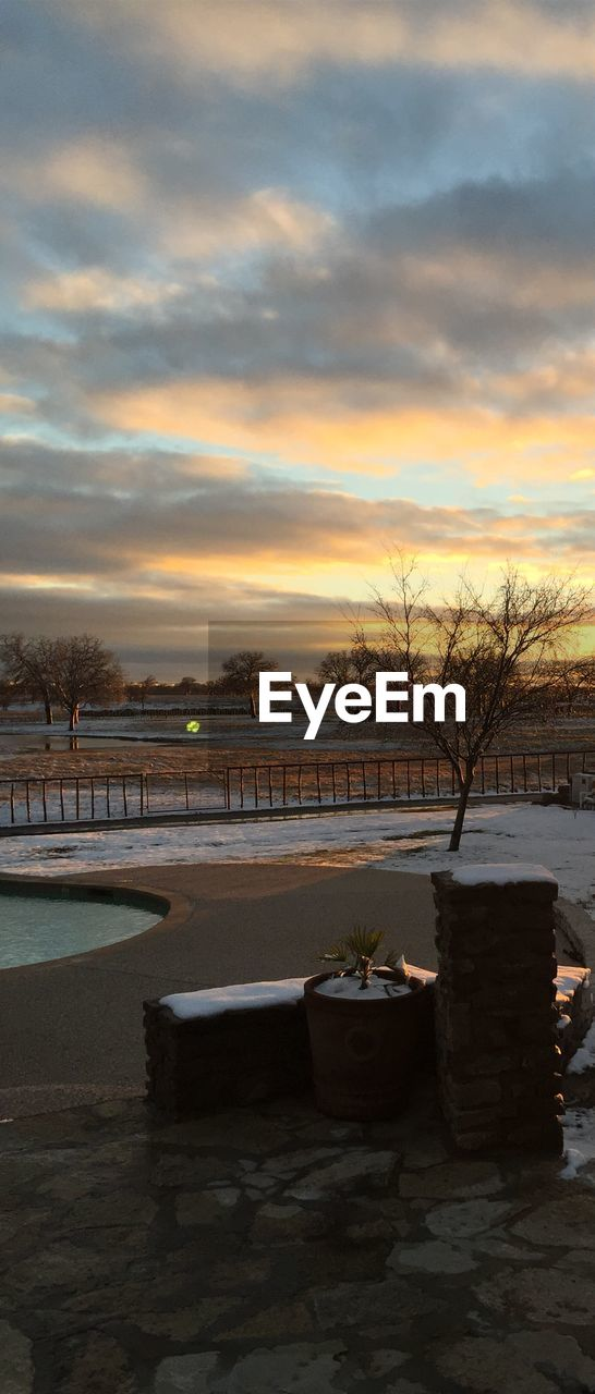 Scenic view of sunset over park during winter
