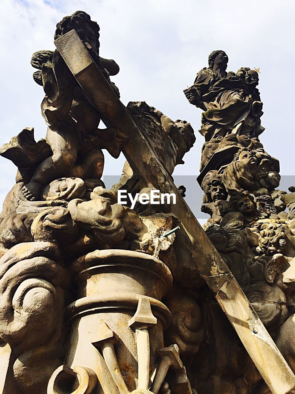 sculpture, statue, art and craft, human representation, representation, male likeness, low angle view, creativity, craft, no people, day, sky, architecture, the past, history, nature, female likeness, outdoors, memorial, built structure, government, ornate