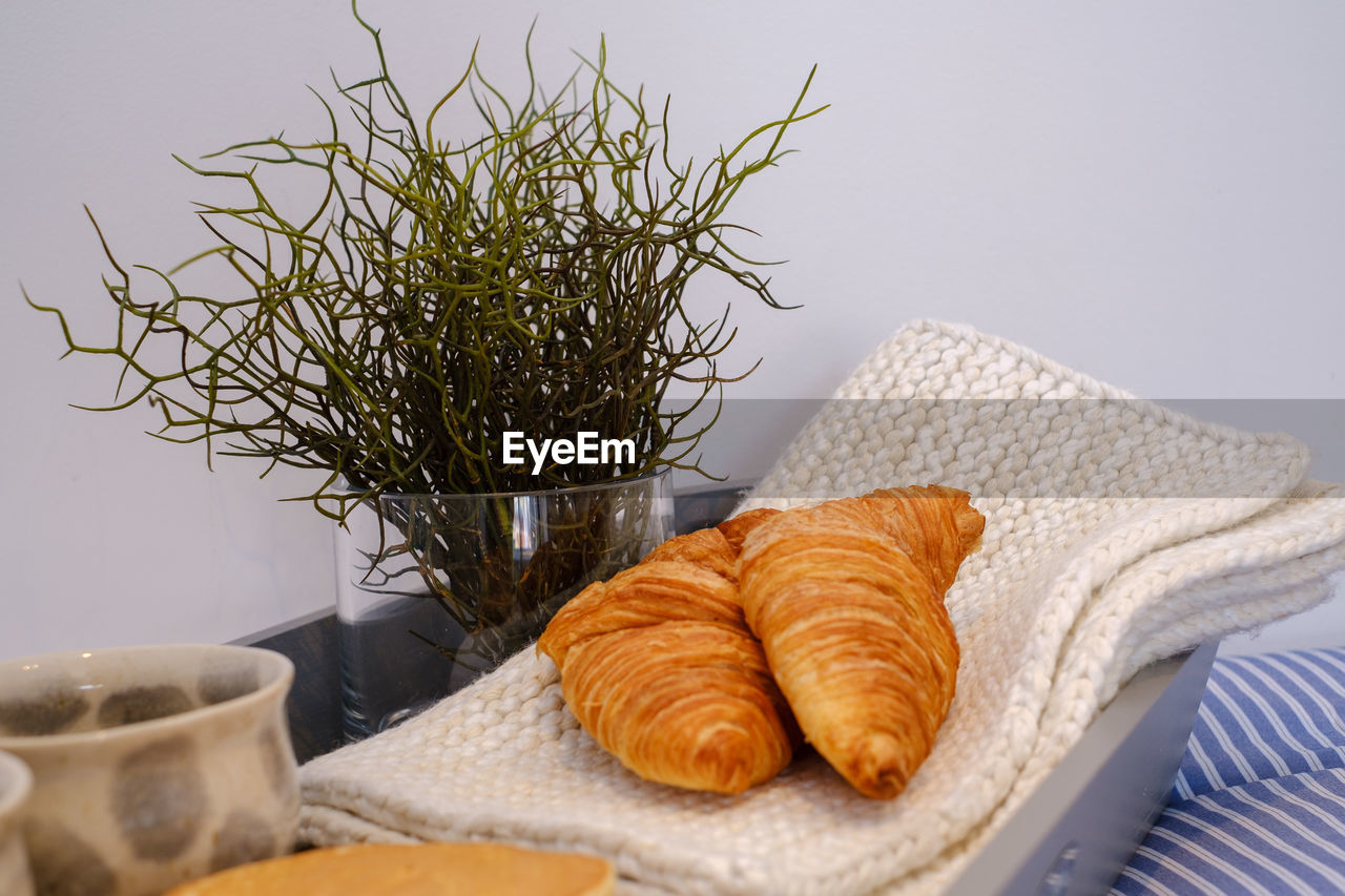 Close-up of croissants on napkins