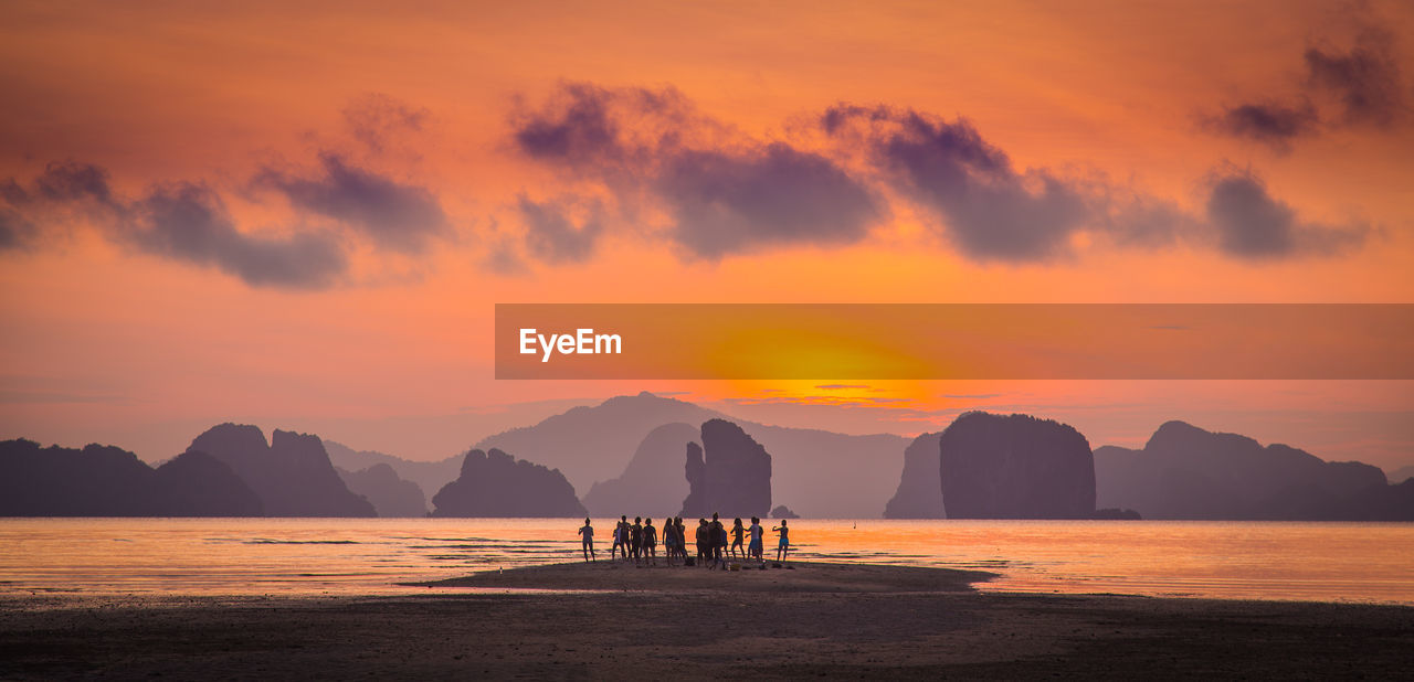 sunset, sky, scenics - nature, beauty in nature, water, orange color, cloud - sky, sea, silhouette, mountain, tranquil scene, tranquility, land, beach, nature, idyllic, mountain range, outdoors, non-urban scene, no people