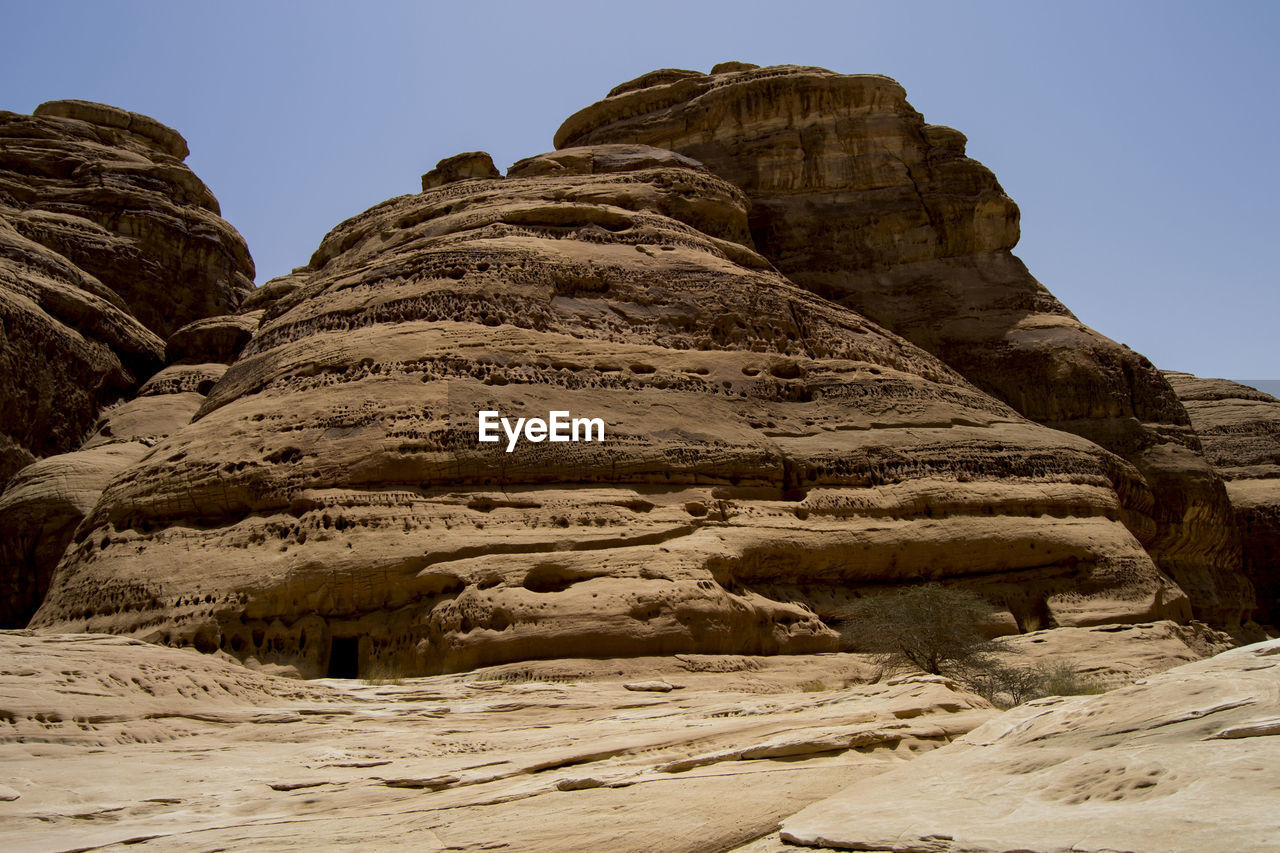 rock, sky, rock - object, solid, rock formation, nature, scenics - nature, beauty in nature, geology, tranquility, tranquil scene, clear sky, low angle view, no people, mountain, non-urban scene, environment, physical geography, day, travel, outdoors, formation, eroded, mountain peak, climate, arid climate