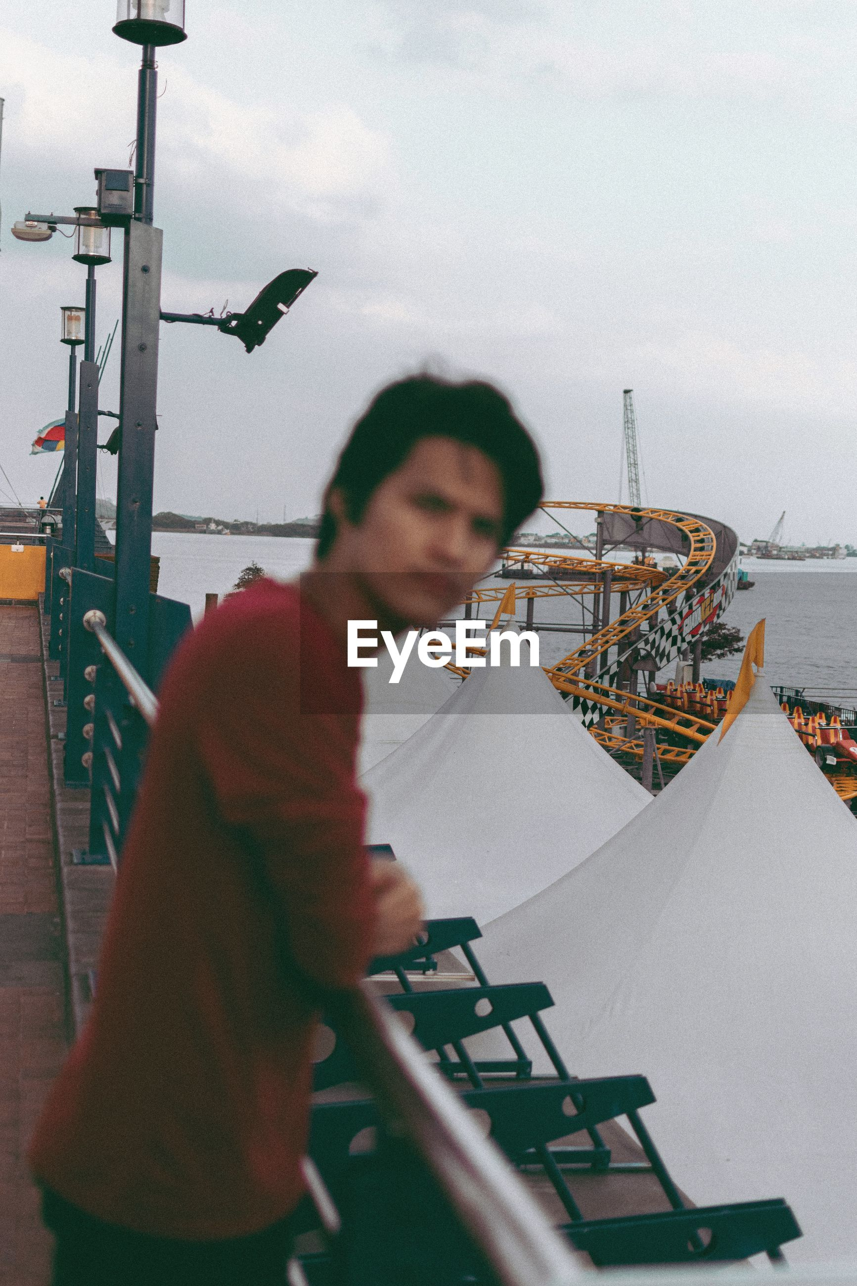 Man standing at harbor