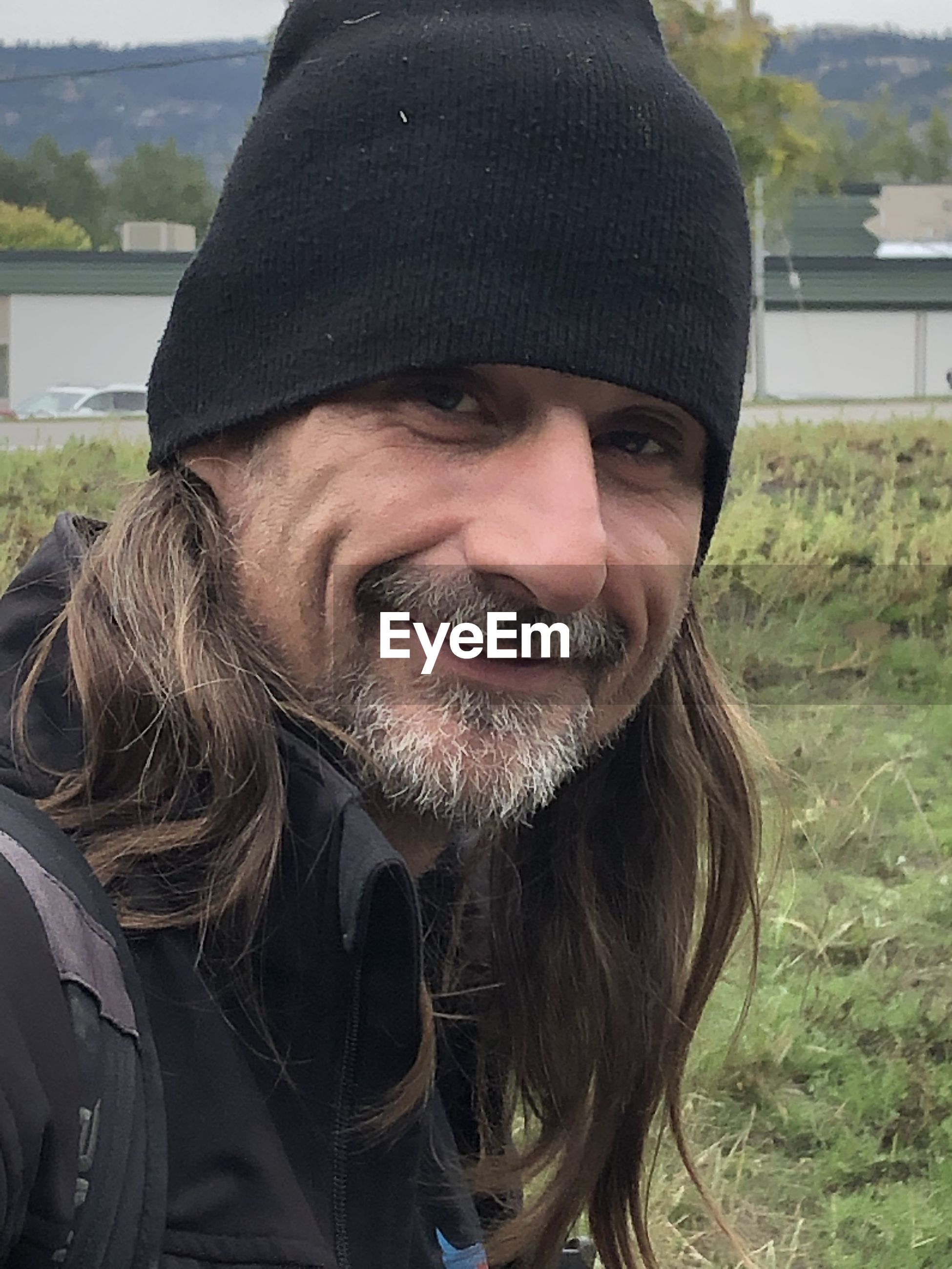 Portrait of smiling man wearing hat