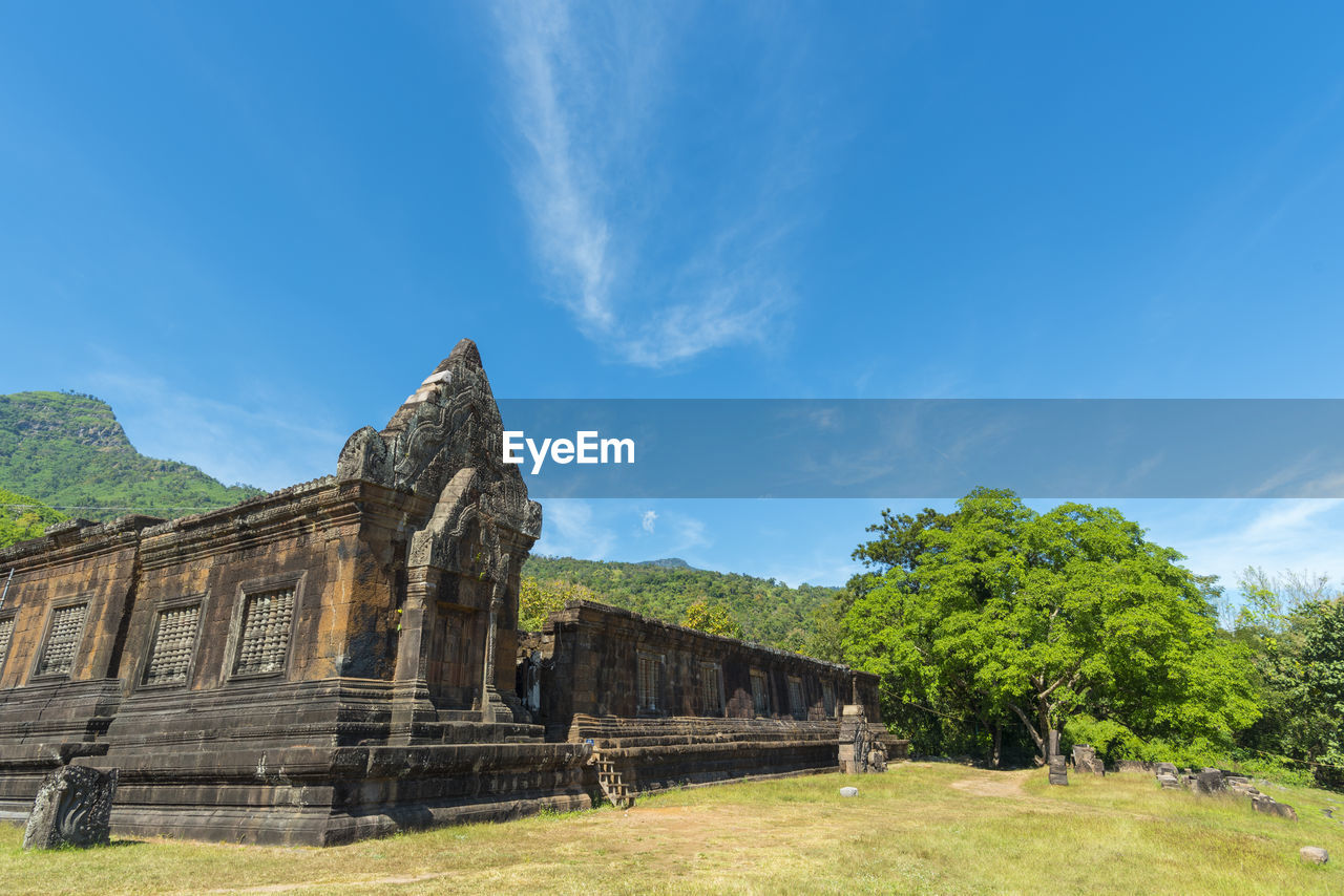 sky, built structure, architecture, the past, history, ancient, nature, old ruin, plant, day, cloud - sky, old, building exterior, blue, travel destinations, ancient civilization, no people, archaeology, tree, travel, outdoors, ruined