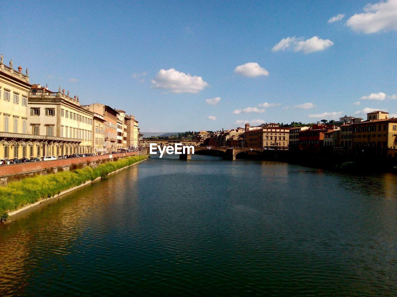 Ponte Vecchio Over River Amidst Buildings Against Sky