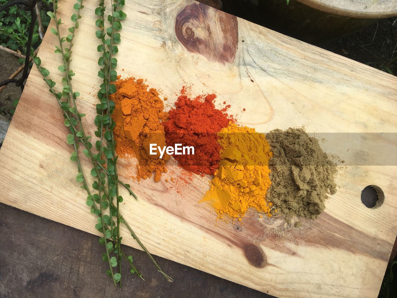 table, indoors, wood - material, close-up, still life, spice, high angle view, no people, variation, food and drink, choice, ground - culinary, food, turmeric, multi colored, freshness, ingredient, kitchen utensil, wellbeing, red