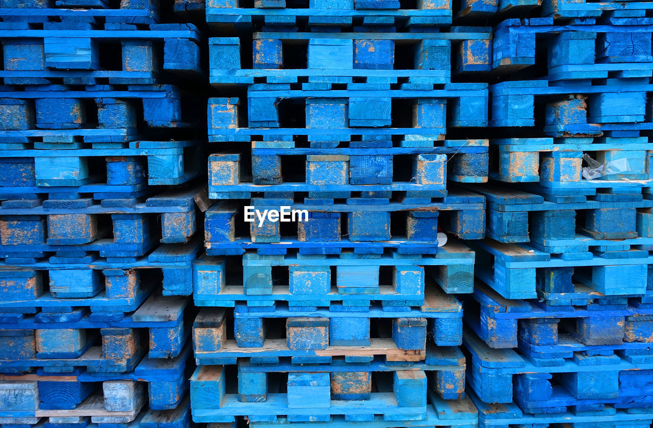 full frame, backgrounds, blue, pattern, stack, no people, large group of objects, abundance, textured, construction industry, industry, built structure, architecture, day, repetition, brick, container, heap, metal, close-up, concrete