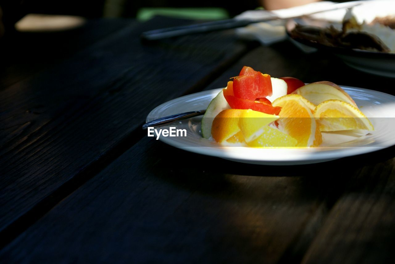 High angle view of fruits served on table