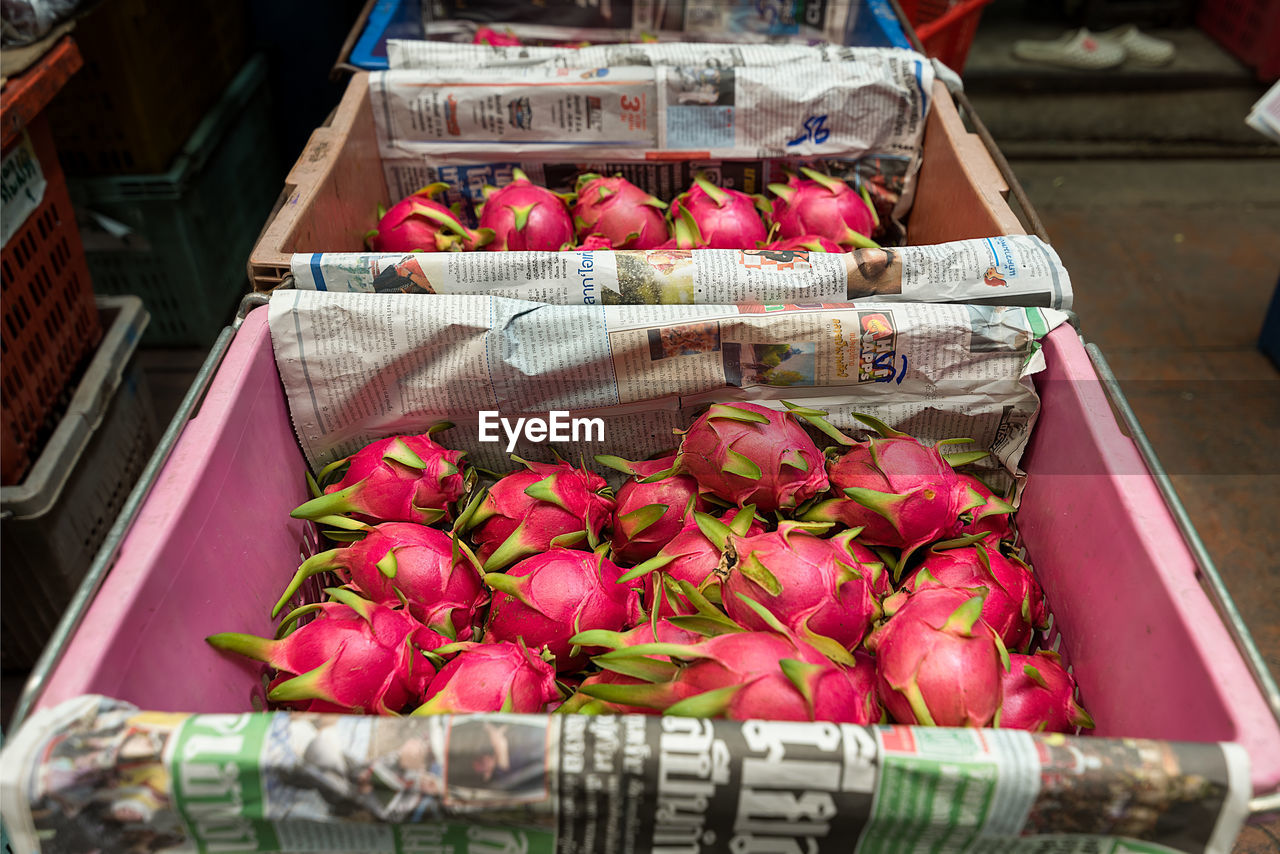 High Angle View Of Pitayas In Crate For Sale At Market Stall