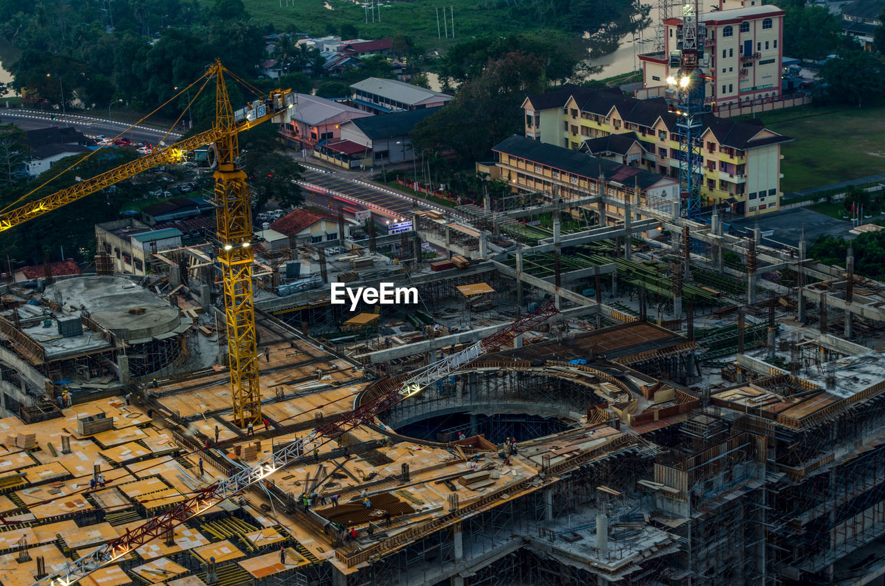 High Angle View Of Crane Amidst Incomplete Building In Town