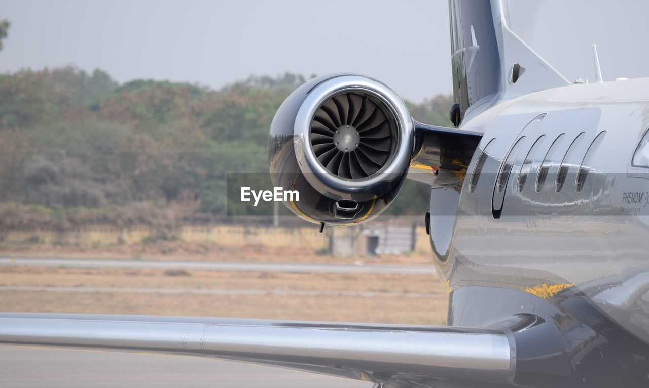 Close-Up Of Airplane On Airport Runway