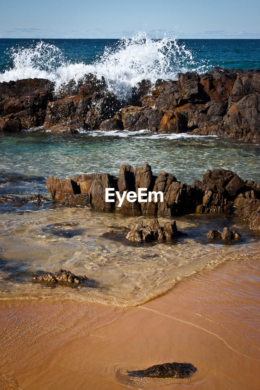 sea, water, rock, rock - object, solid, beach, land, motion, wave, sky, beauty in nature, nature, horizon over water, horizon, scenics - nature, day, splashing, rock formation, no people, outdoors, power in nature, breaking, hitting