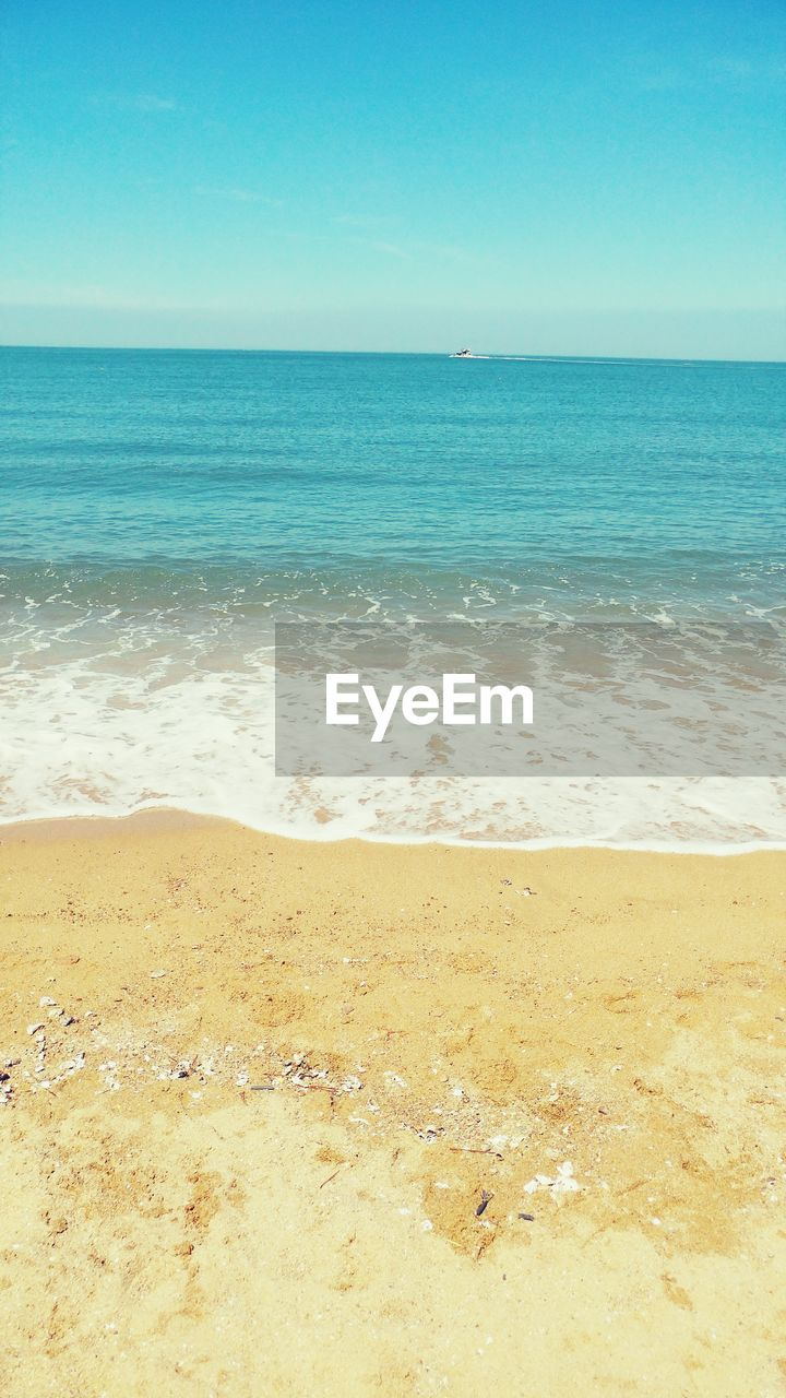 sea, beach, horizon over water, water, sand, scenics, beauty in nature, nature, shore, tranquil scene, tranquility, clear sky, no people, day, outdoors, blue, sky
