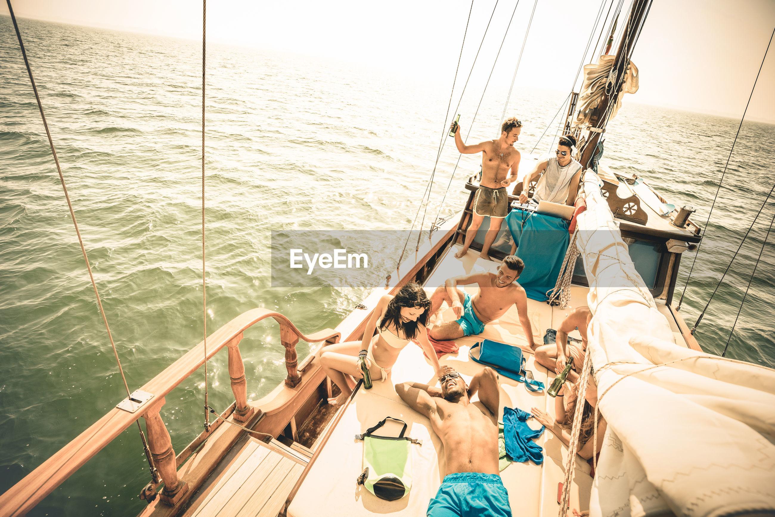 Friends in boat on sea