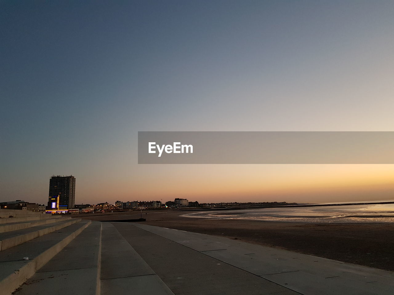 sky, sunset, clear sky, copy space, nature, transportation, airport, architecture, no people, orange color, built structure, airport runway, road, mode of transportation, building exterior, beauty in nature, outdoors, scenics - nature, air vehicle, city