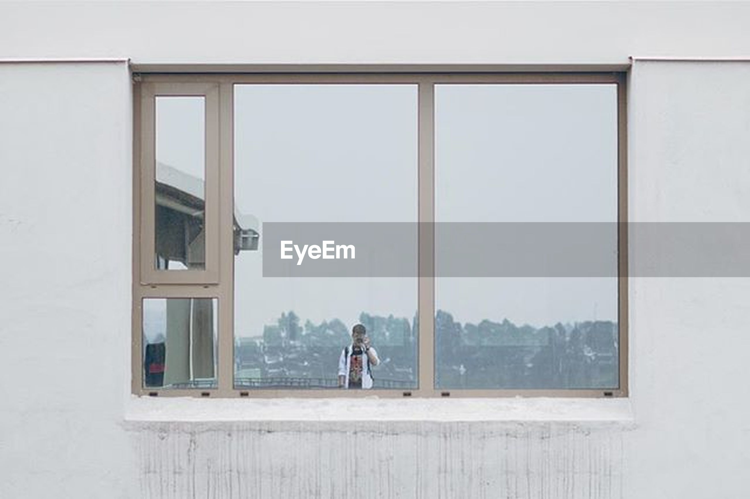 window, architecture, built structure, glass - material, building exterior, indoors, transparent, lifestyles, men, day, leisure activity, person, reflection, copy space, building, city, house, looking through window