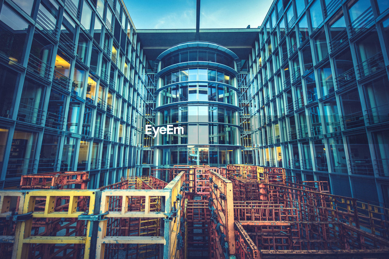 built structure, architecture, building exterior, building, low angle view, city, modern, glass - material, no people, office building exterior, window, office, reflection, illuminated, outdoors, day, nature, dusk, industry