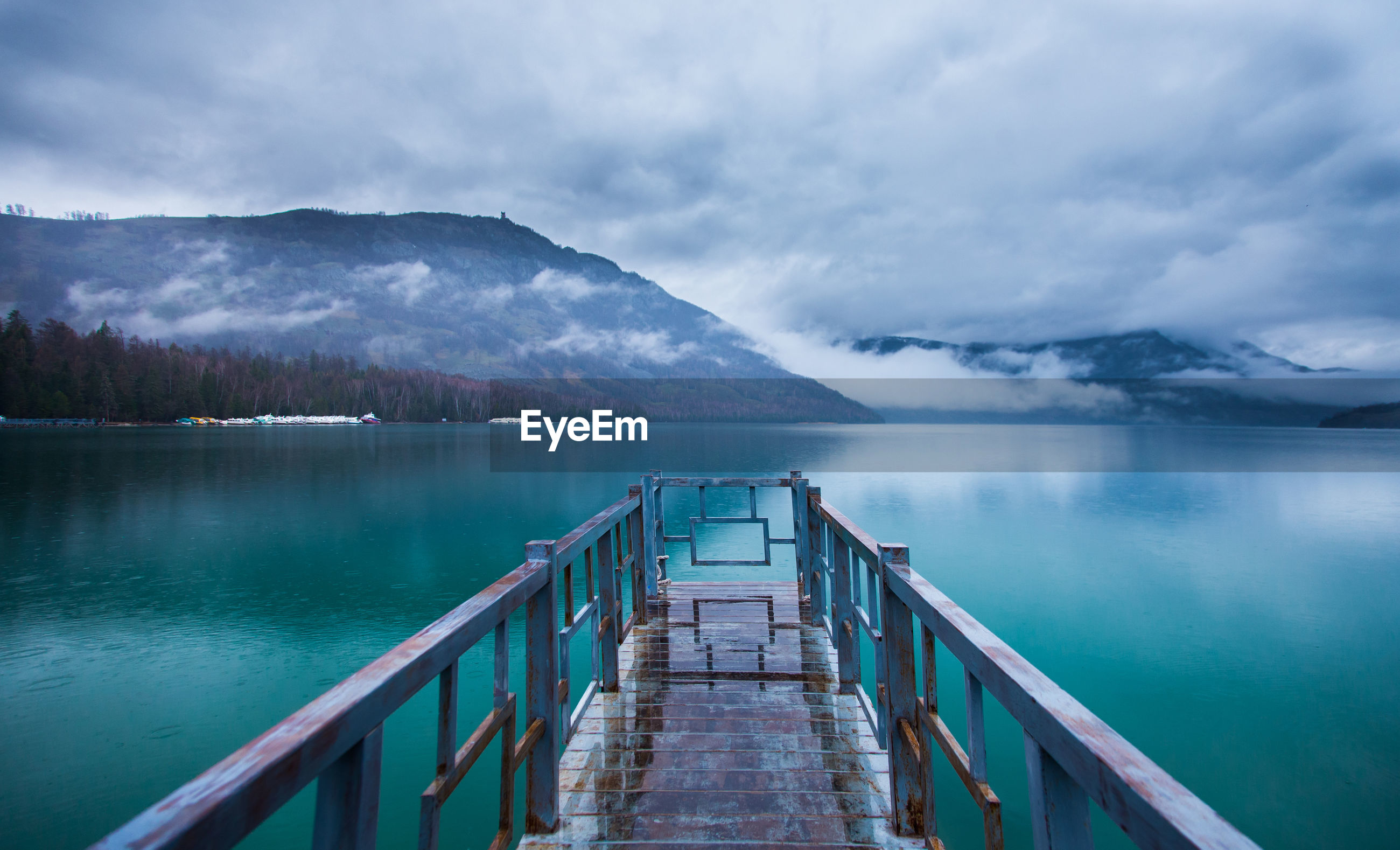 Scenic view of jetty on lake