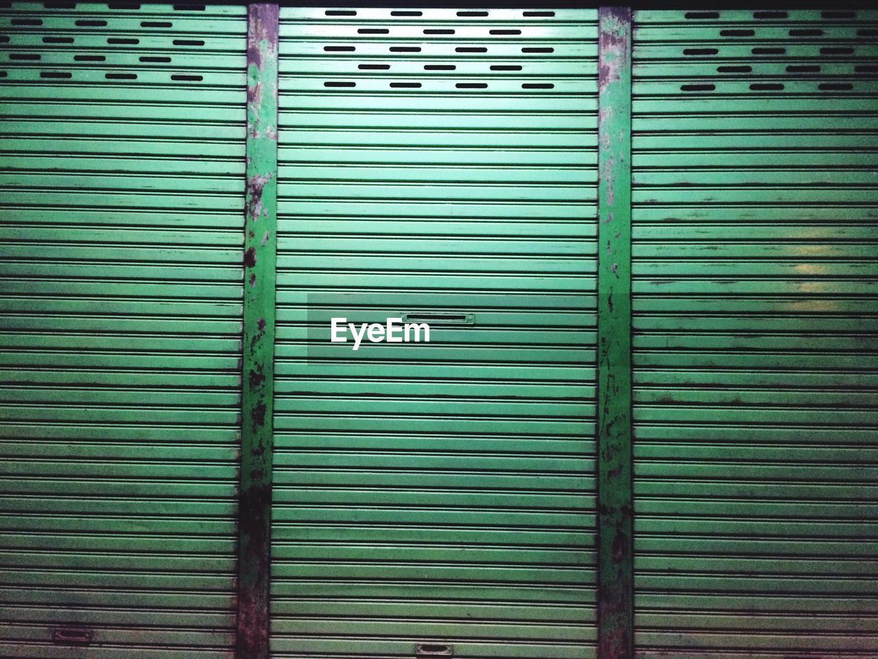 closed, pattern, shutter, security, backgrounds, corrugated iron, safety, full frame, striped, protection, day, no people, textured, green color, store, outdoors, architecture, close-up