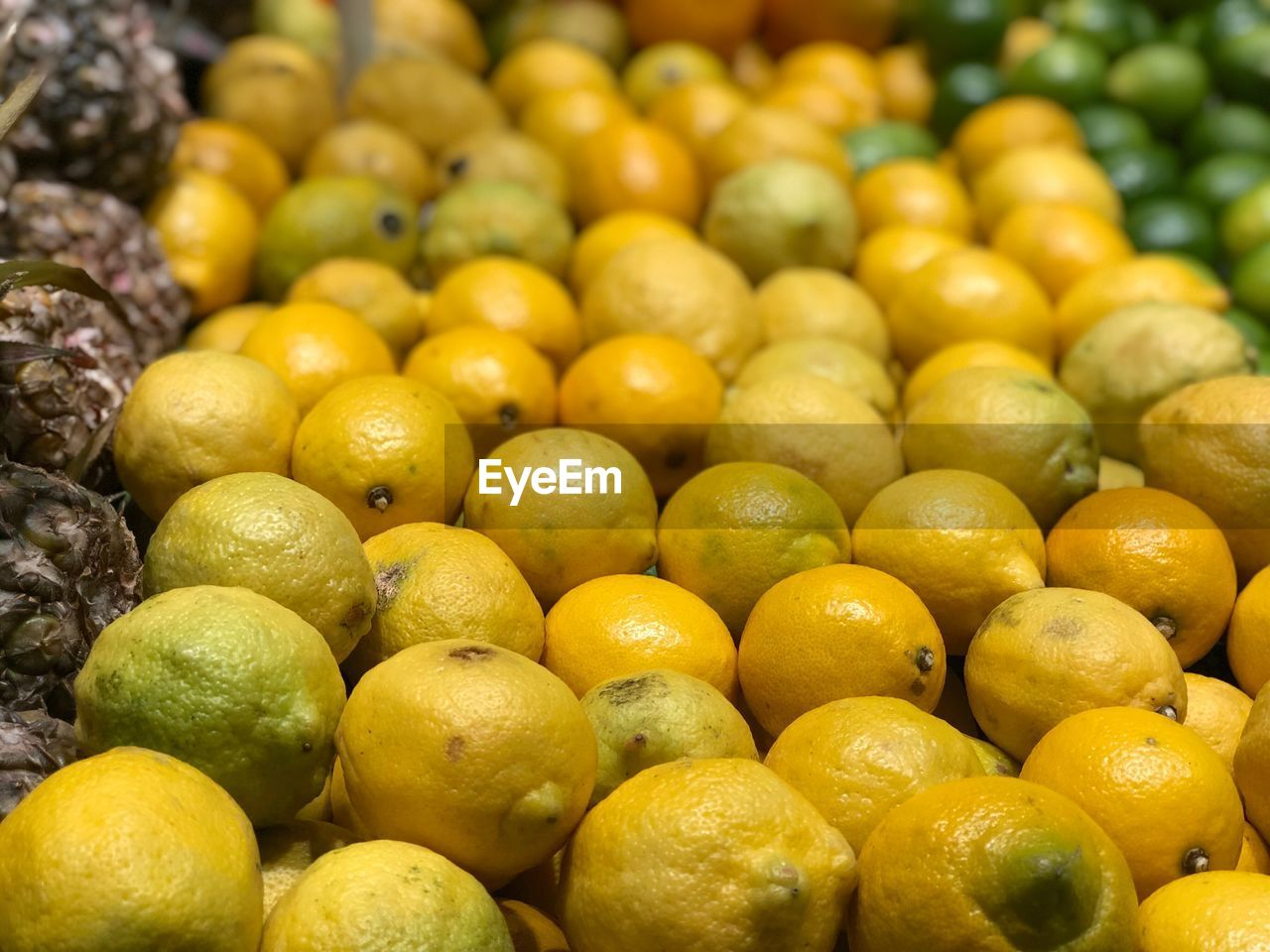 food and drink, food, healthy eating, fruit, freshness, wellbeing, for sale, market, abundance, yellow, retail, market stall, large group of objects, no people, close-up, still life, citrus fruit, choice, focus on foreground, small business, retail display, orange, ripe