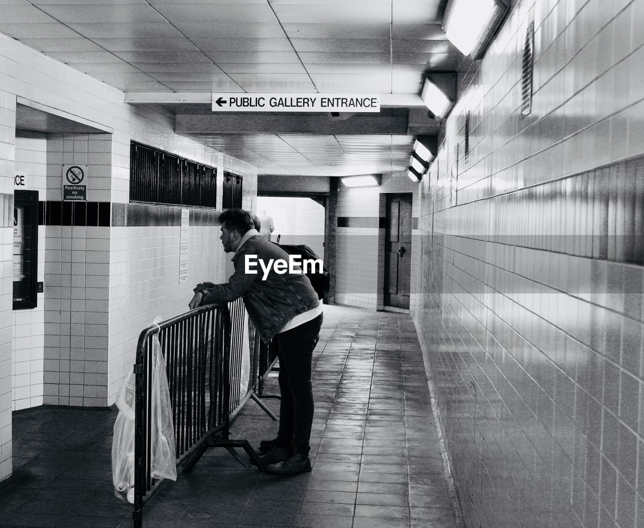 Rear view of man in subway