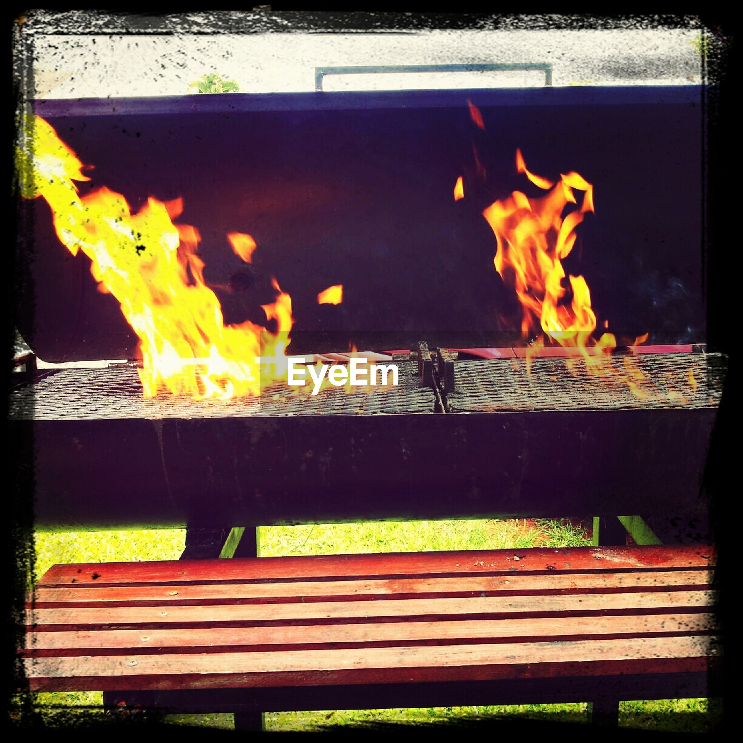 transfer print, auto post production filter, wood - material, outdoors, yellow, night, sunlight, burning, flame, fire - natural phenomenon, no people, heat - temperature, close-up, orange color, fence, nature, wood, wall - building feature, glowing
