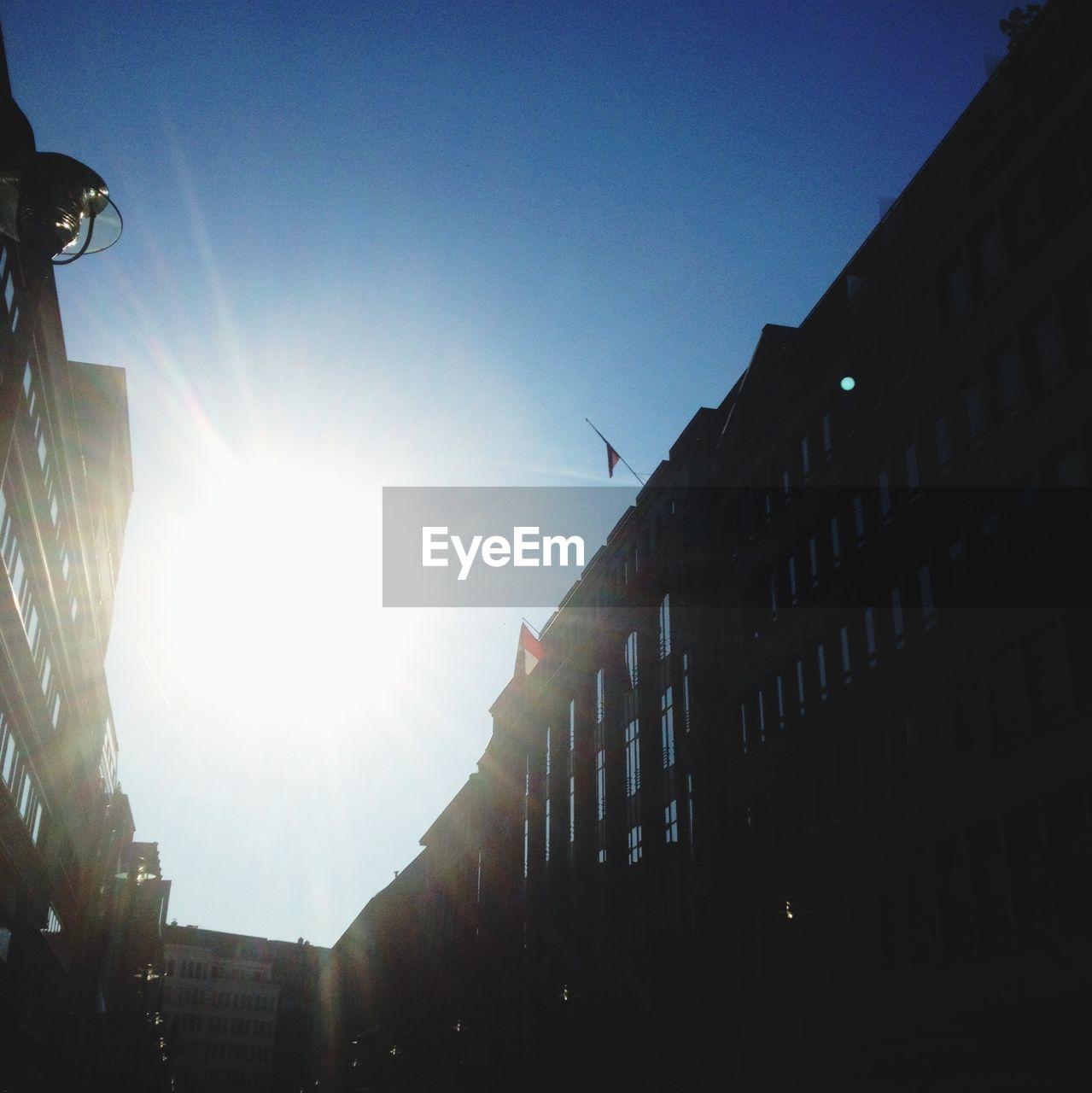 Sun shining over buildings