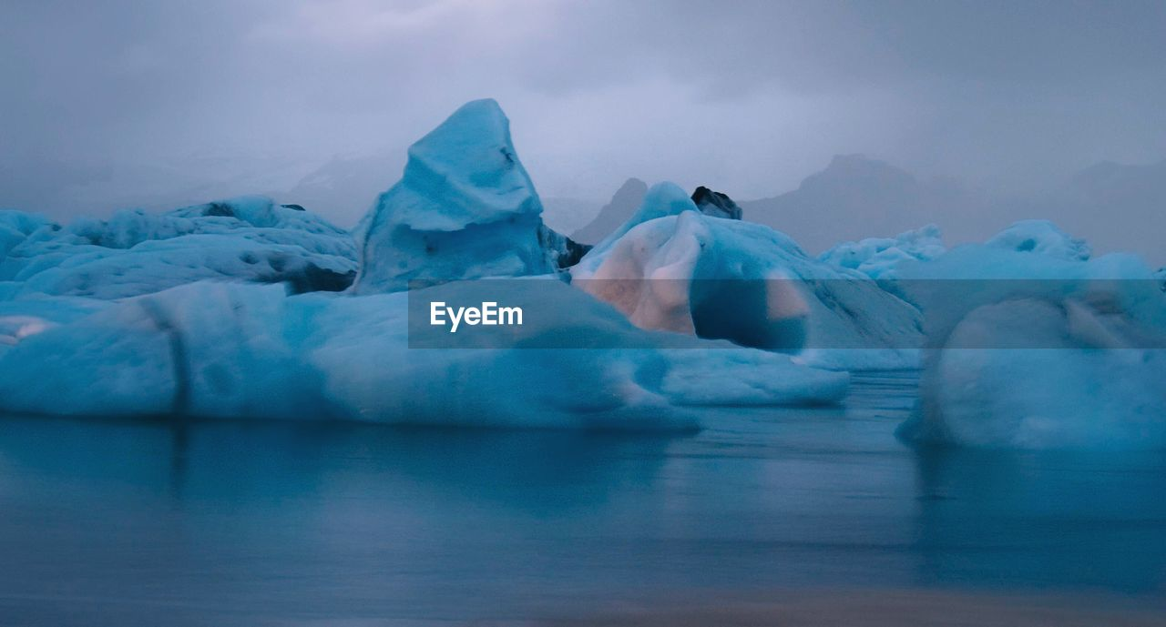 cold temperature, ice, glacier, iceberg, beauty in nature, frozen, winter, waterfront, nature, tranquil scene, tranquility, scenics, lake, water, floating on water, no people, snow, outdoors, sky, day