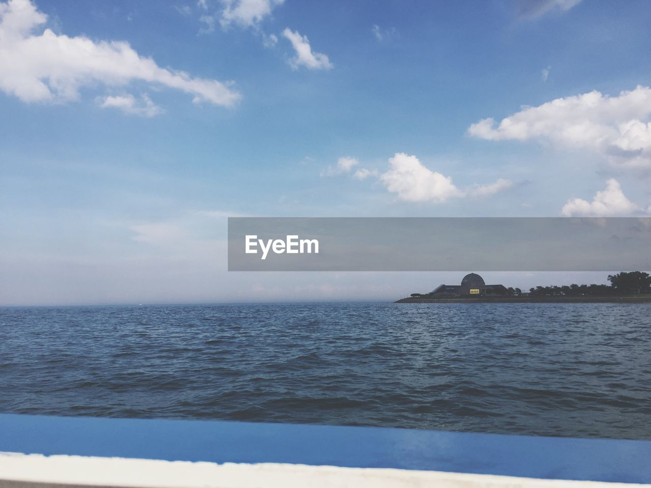 sea, sky, cloud - sky, scenics, water, tranquility, nature, beauty in nature, tranquil scene, outdoors, horizon over water, no people, day, waterfront, travel destinations, beach, architecture