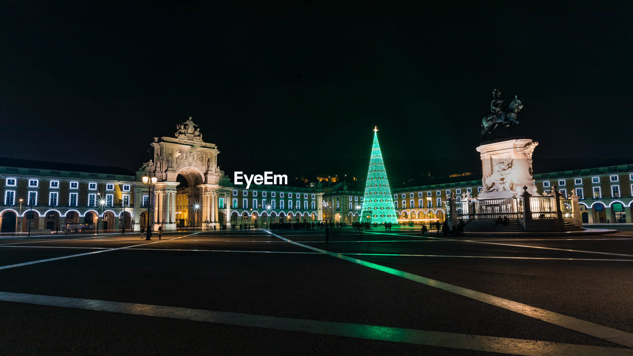 illuminated, architecture, night, built structure, travel destinations, building exterior, city, the past, history, tourism, travel, sky, road, transportation, incidental people, nature, street, symbol, road marking, outdoors, government, architectural column