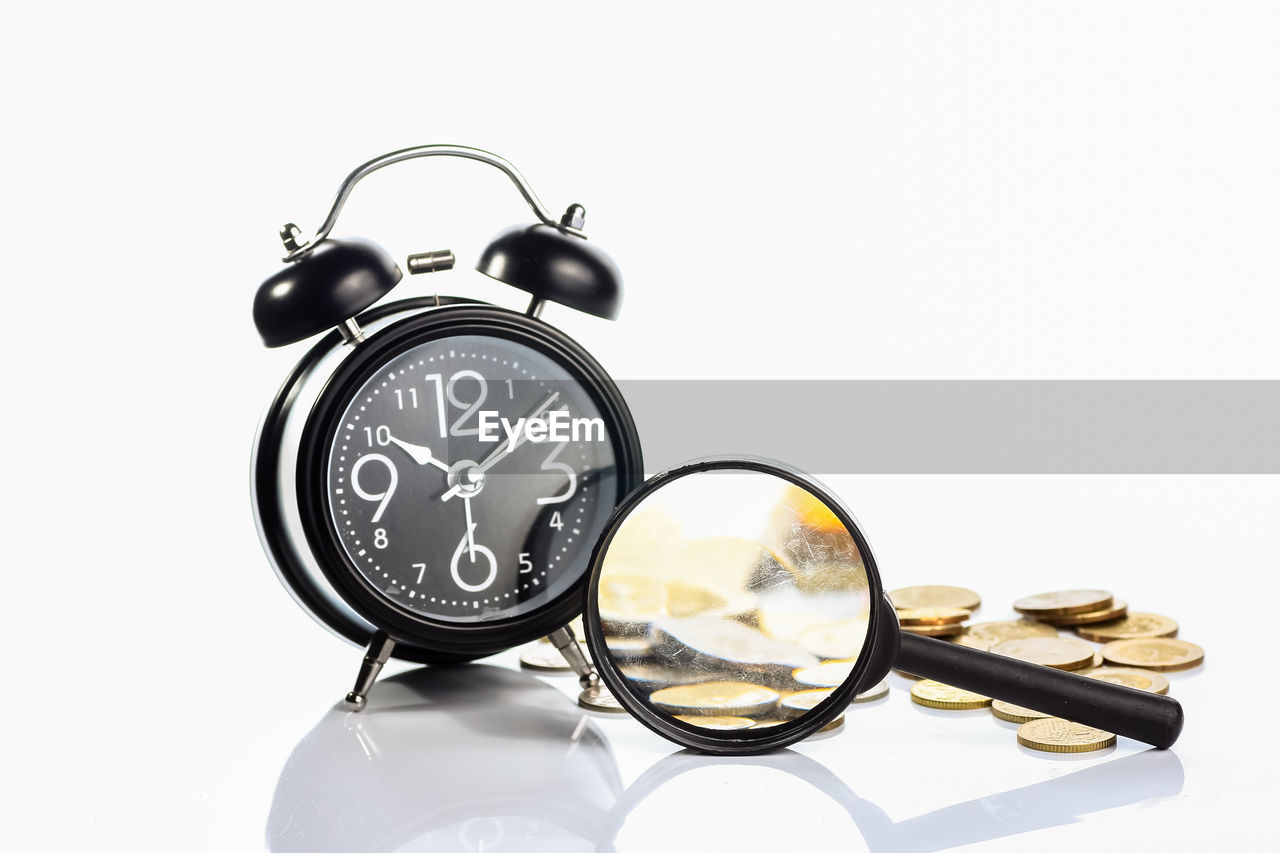 white background, studio shot, clock, indoors, alarm clock, still life, copy space, close-up, time, number, no people, accuracy, glasses, transparent, cut out, glass - material, retro styled, personal accessory, single object, clock face, minute hand