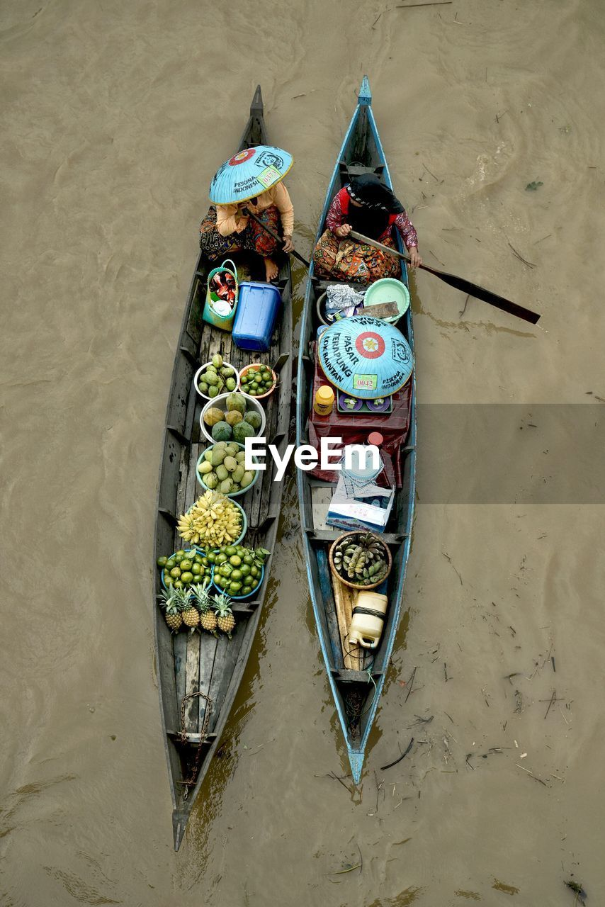 High Angle View Of Vendors With Food For Sale In Boat