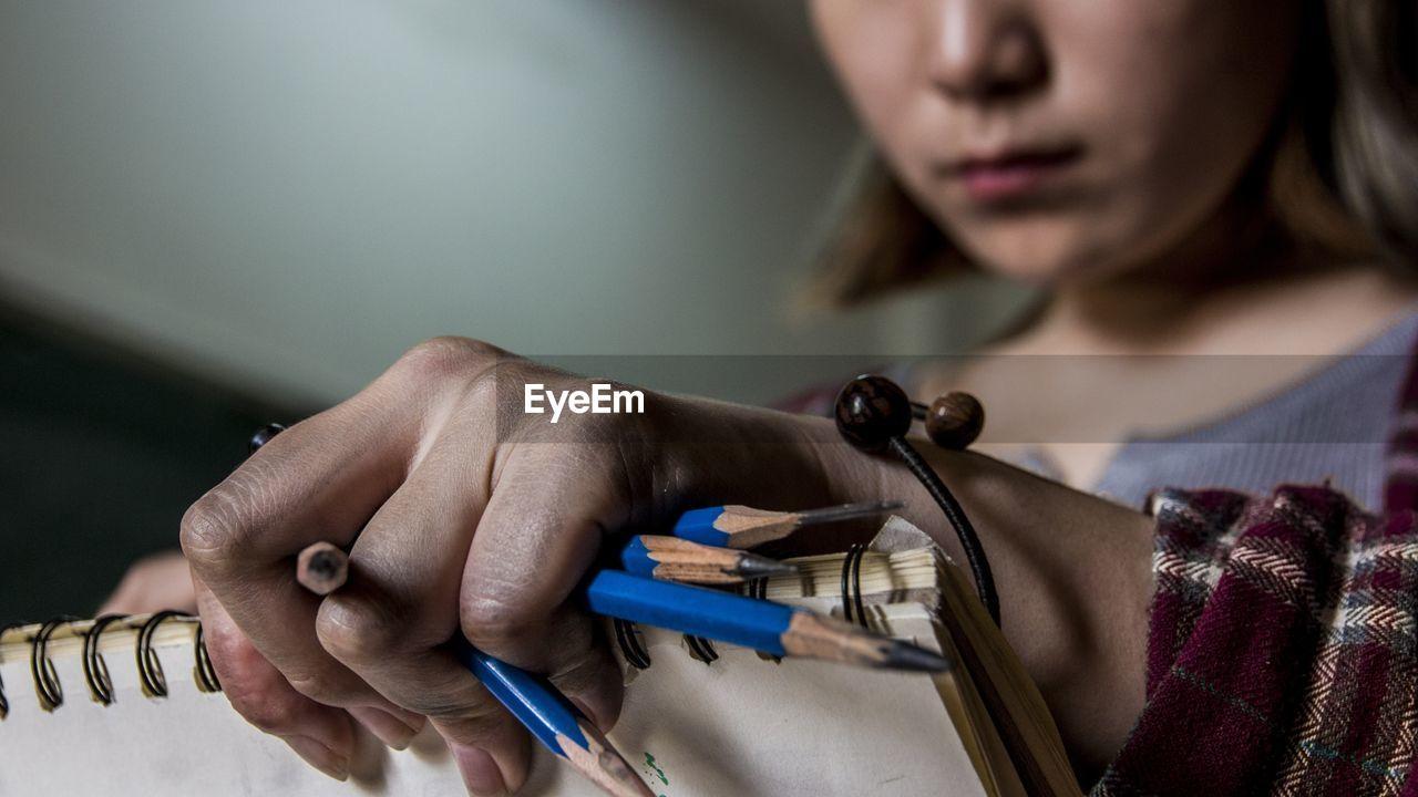Close-Up Of Woman Drawing
