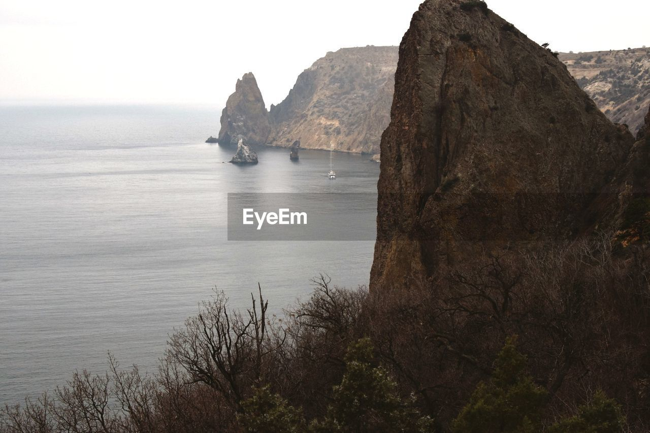 water, sea, tranquility, rock, tranquil scene, beauty in nature, scenics - nature, sky, nature, rock - object, no people, day, rock formation, land, solid, non-urban scene, cliff, idyllic, clear sky, outdoors, formation, stack rock, eroded