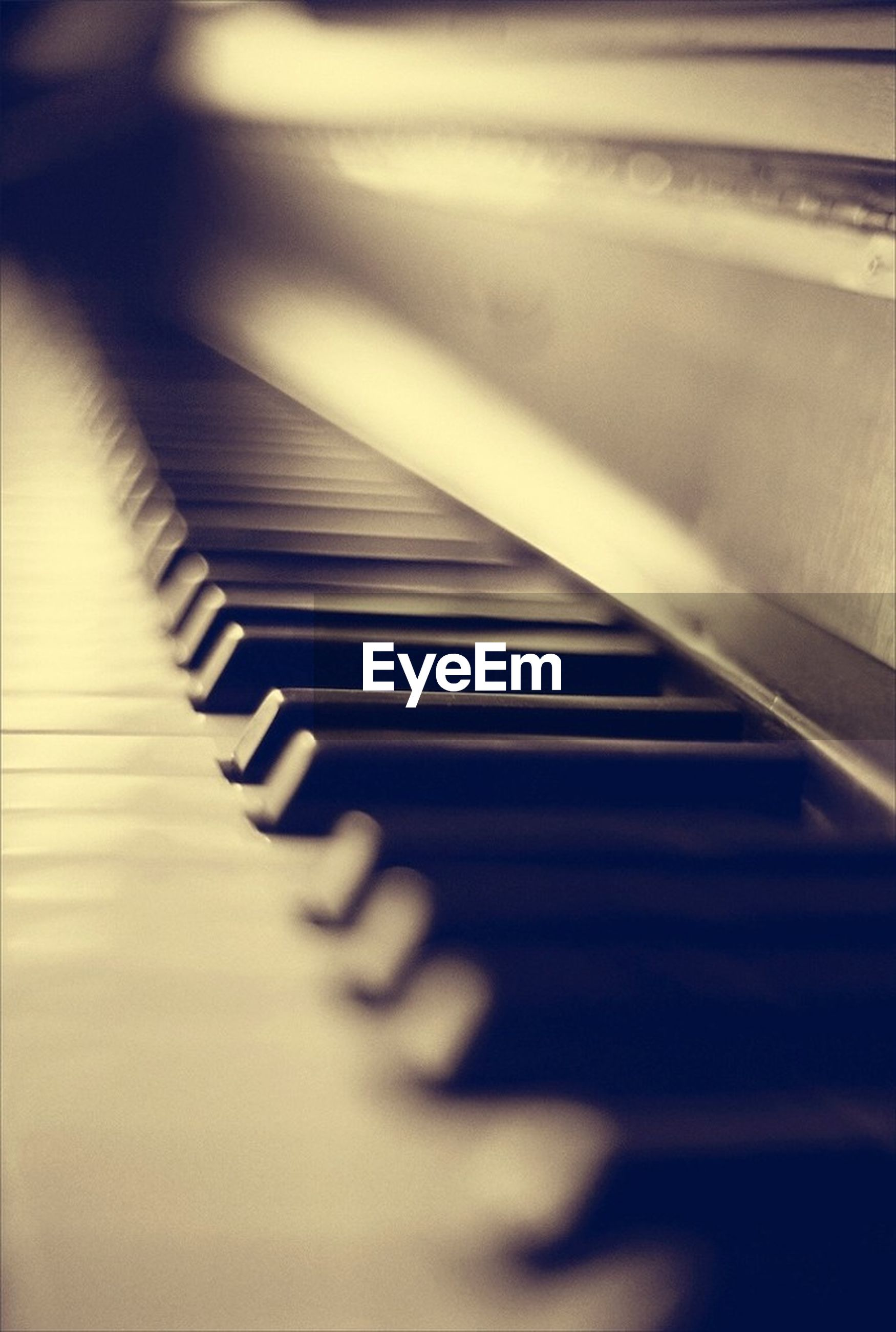 indoors, music, close-up, piano key, musical instrument, arts culture and entertainment, piano, selective focus, high angle view, musical equipment, still life, part of, no people, in a row, technology, shadow, metal, focus on foreground, pattern, detail