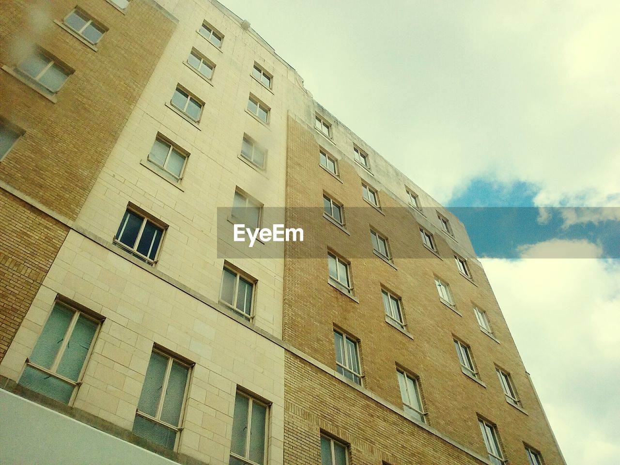 window, architecture, building exterior, built structure, low angle view, sky, no people, day, apartment, city, modern, outdoors, residential