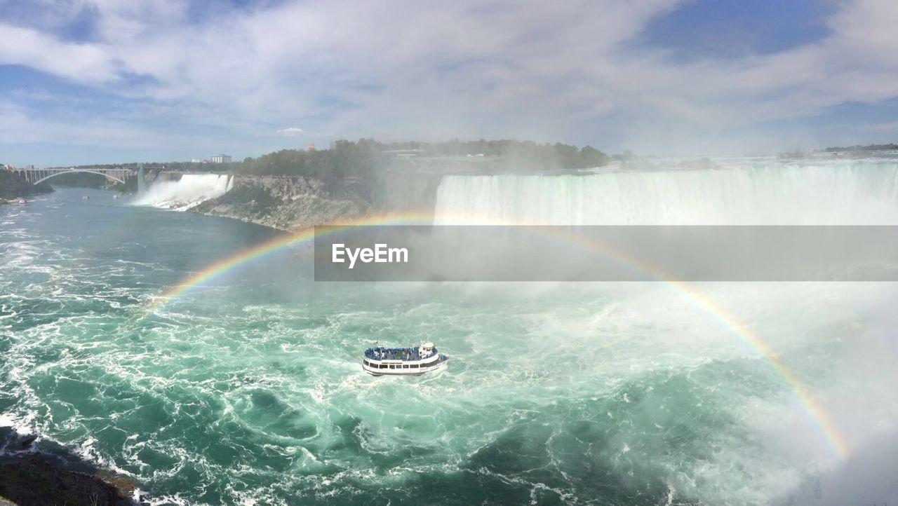 High Angle View Of Ferry Sailing Below Rainbow By Niagara Falls