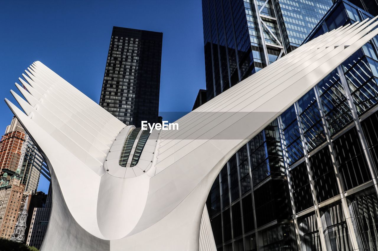 built structure, architecture, building exterior, building, office building exterior, city, modern, low angle view, sky, office, no people, skyscraper, tall - high, day, nature, clear sky, tower, sunlight, outdoors, glass - material, financial district