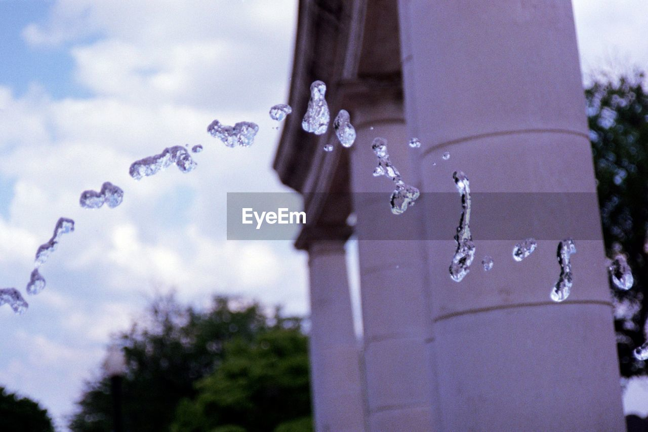 water, focus on foreground, nature, day, no people, close-up, drop, plant, outdoors, cloud - sky, sky, tree, motion, selective focus, architecture, cold temperature, faucet, roof, icicle, purity